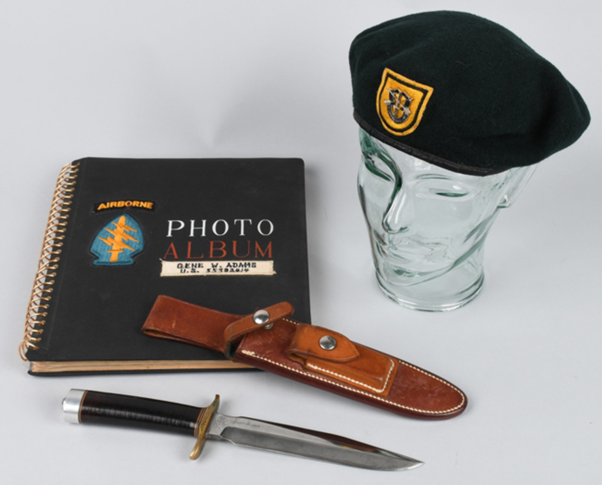 Outstanding circa-1966 archive of Vietnam 5th Special Forces 1st Group items belonging to Gene W. Adams. Includes green beret, Randall fighting knife with scabbard, and photo album. Image courtesy of Milestone Auctions