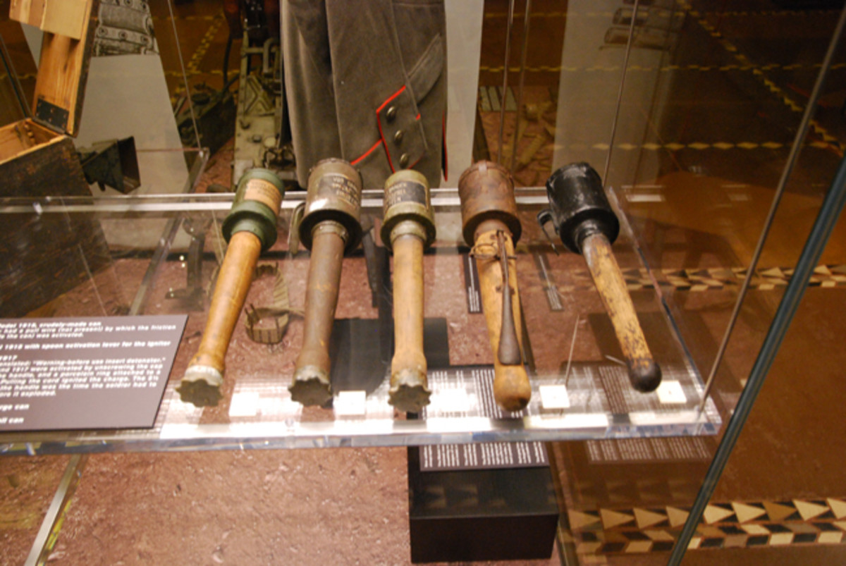 """A collection of German """"potato masher"""" hand grenades."""