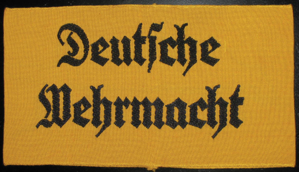 "When working with the armed services, TENO members often wore a ""Deutsche Wehrmacht"" armband."