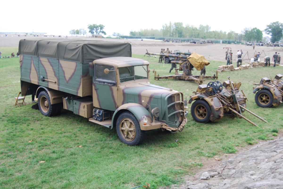 Undeterred by the German defenses, amphibious vehicles continued to ferry troops and supplies to the battlefield.