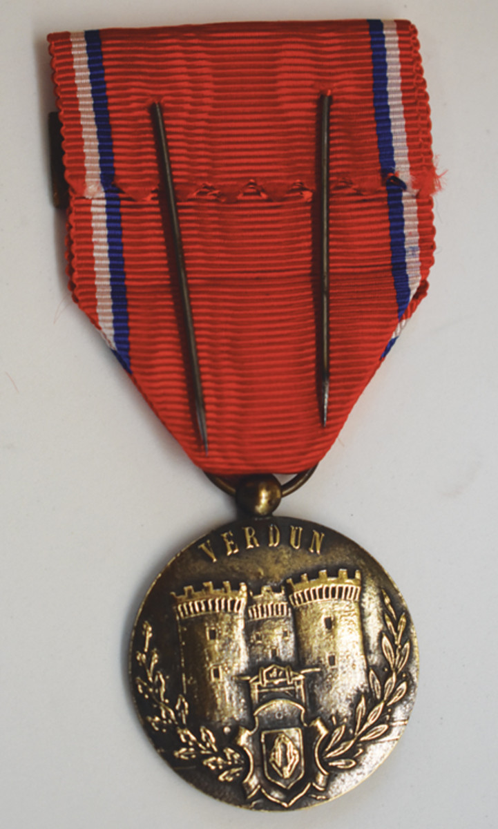 The reverse of the Augier Medal shows the typical double pins used on many French medals.