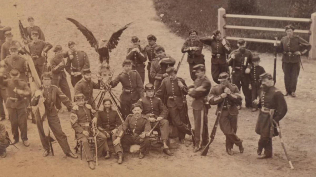 1861 Civil War mammoth-plate albumen print depicting the 8th Wisconsin Volunteer Infantry Regiment with their eagle mascot 'Old Abe,' 13½ x 19in (sight). Image courtesy of Milestone Auctions