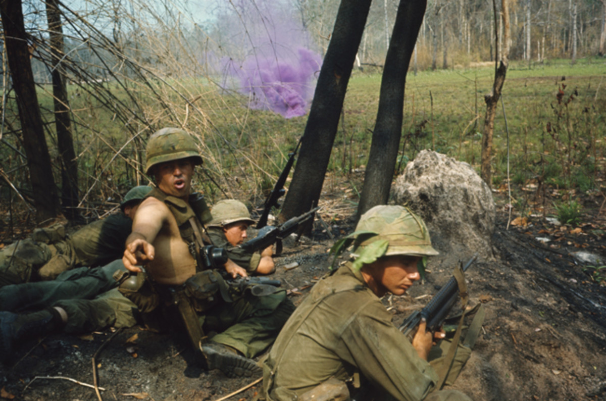 "By the middle of the Vietnam War, the M26A1 / M61 fragmentation was standard issue. The Army of the Republic of Vietnam (ARVN) allies, however, still used plenty of surplus WWII weapons — including MK II grenades. For one Veteran, these old ""pineapples"" were the ideal souvenir to send home. Photo of US troops marking an LZ (landing Zone) courtesy of the National Archives"