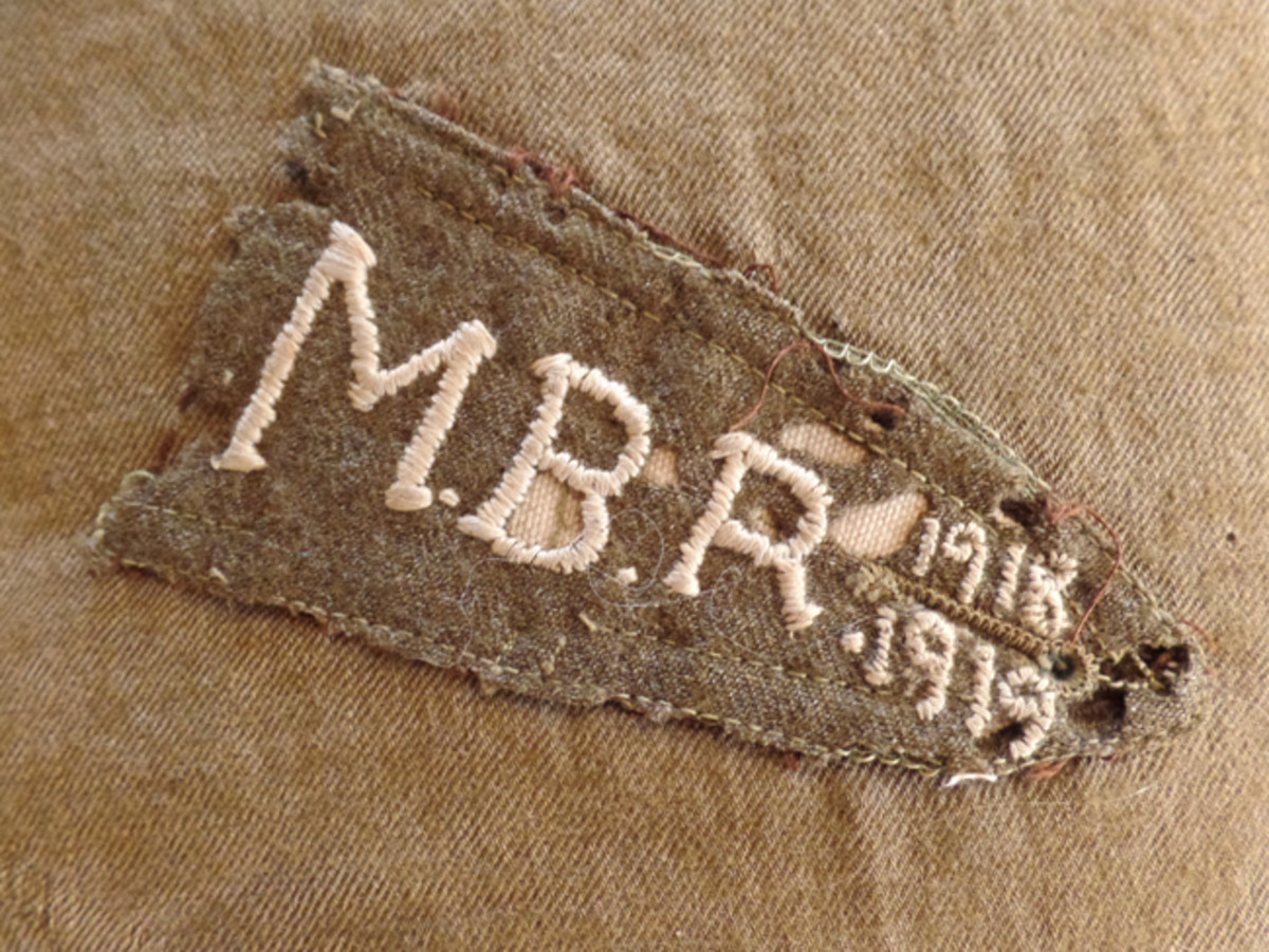 A closer view of the shoulder strap centered on the underside of the pillow shows that it has Rector's MBR initials and the dates 1918-1919. Because of the hectic events surrounding the demobilization of the stateside Army, while Rector's form 724 indicates he was demobilized in December 1918, there is a very good chance he was still out-processing from the Army in early 1919.
