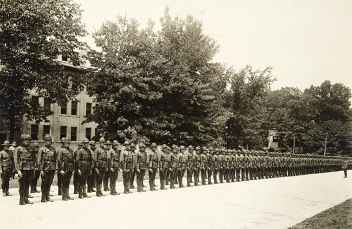 In early 1918, the US War Department created the Student Army Training Corps (SATC) as a way to hasten the training of soldiers for the war. Students in the SATC would simultaneously take college courses and train for the military. The intensive training course at Bliss Electrical School where Maurice Bryant served provided training for electricians. This photo shows SATC drafted men from the Washington, D.C., area installing wires for the electric lights and motors in the wiring laboratory at the school, August 13, 1918. National Archives