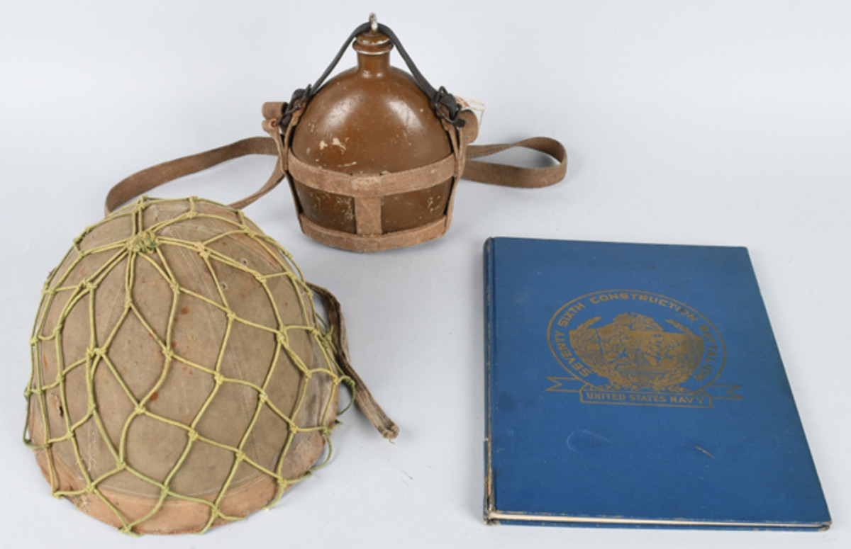 World War II Japanese helmet with camouflage cover and net; plus canteen and original copy of the 76th Construction Battalion unit's history. Image courtesy of Milestone Auctions