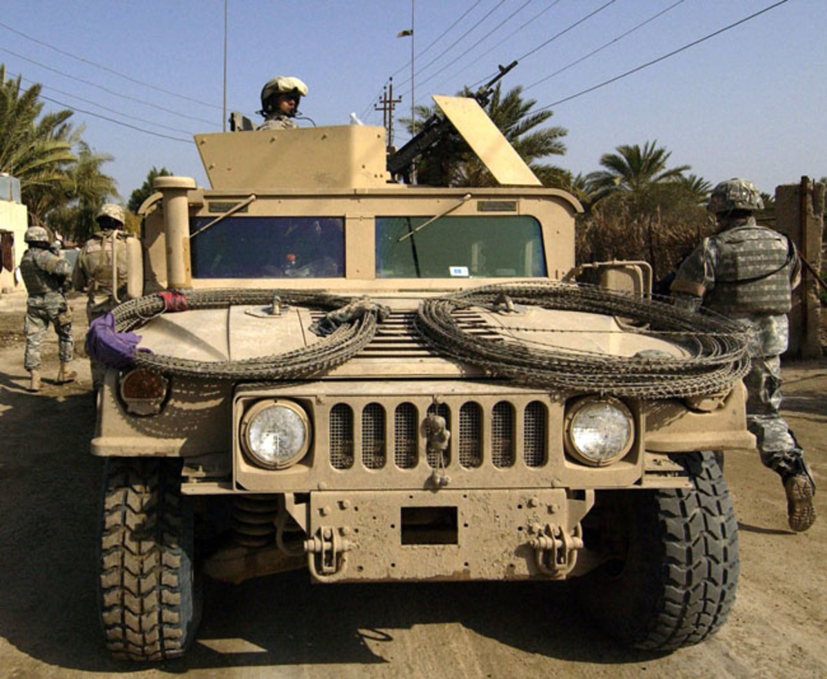 The extended air intake visible here is standard on Marine Corps vehicles. However, on army HMMWVs, like this 10th Mountain Division unit photographed March 14, 2006 in Baghdad, the extended air intake is field installed.