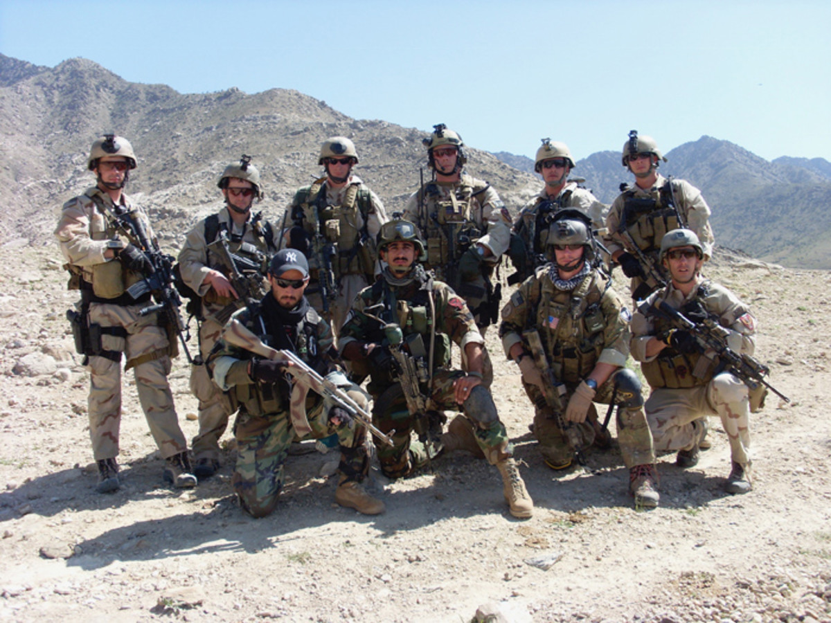 Army Sgt. Matthew Williams and other team members assigned to the 3rd Special Forces Group pose for a photograph as they to be picked up by a helicopter in eastern Afghanistan in late spring 2007.