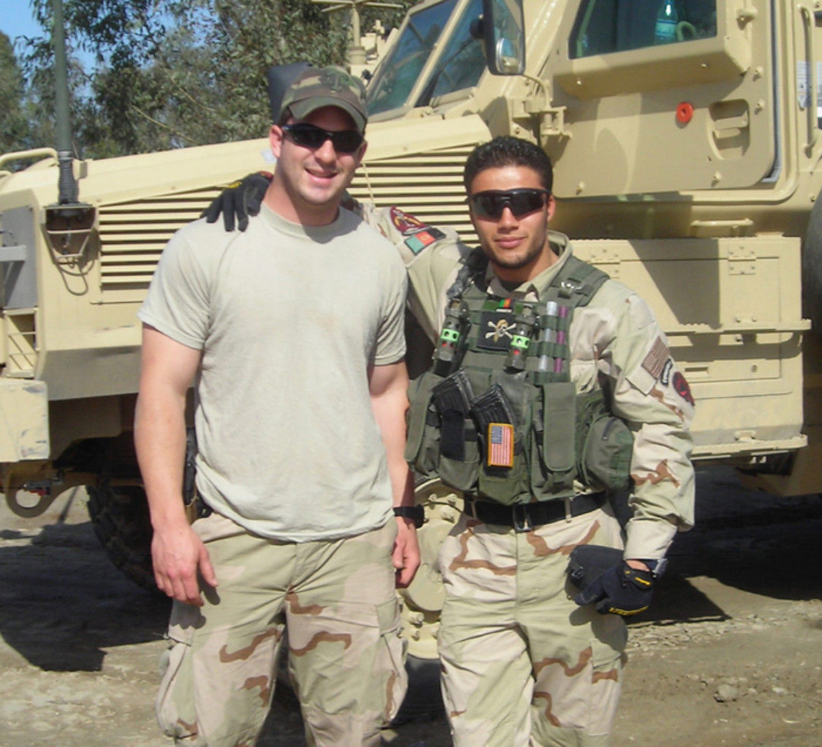 Then-Sgt. Matthew Williams assigned to 3rd Special Forces Group (Airborne), poses with his operational detachment's interpreter in Jalalabad, Afghanistan, spring of 2007. (Photo Courtesy of Master Sgt. Matthew Williams)