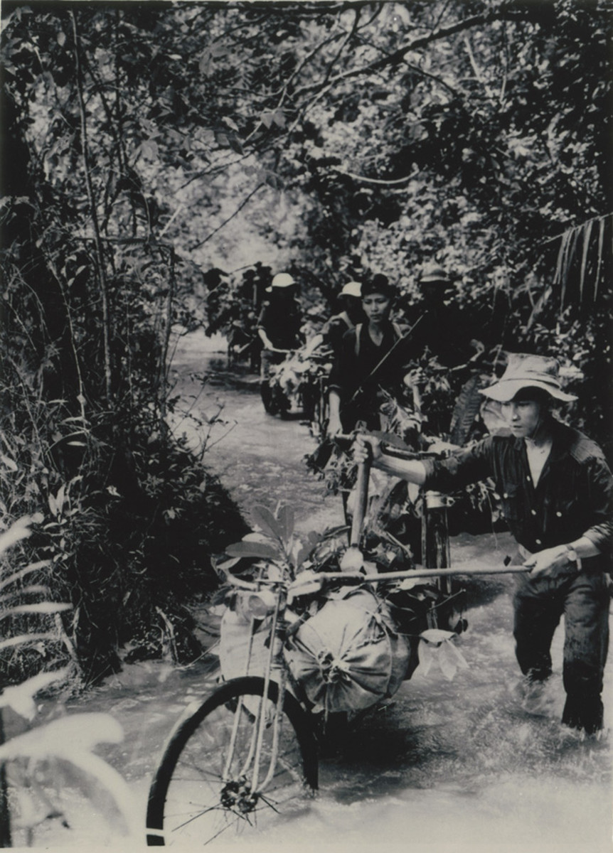 Bicyclists carry food and ammunition down the Ho Chi Minh Trail, 1966.