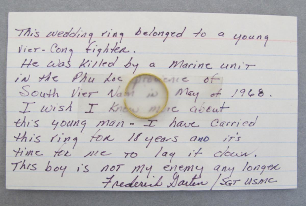 Index card with ring left at the Vietnam Veterans Memorial in Washington, DC.