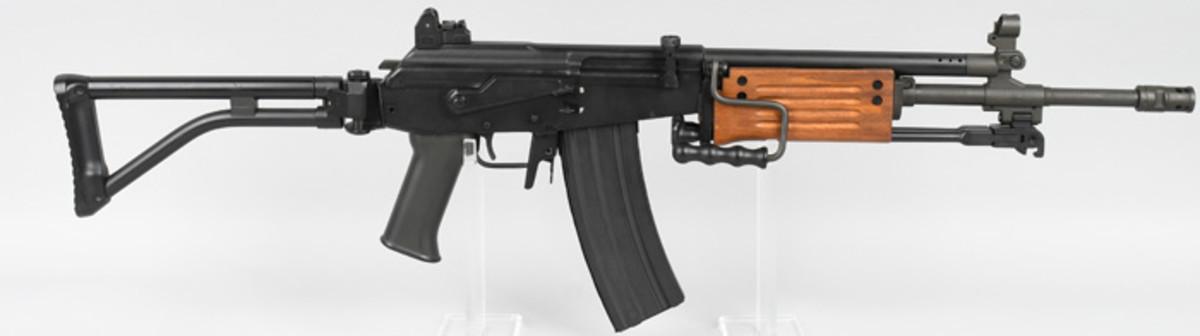 Pre-1989 importation band Israeli Galil semi-automatic rifle, .223 caliber, 16-inch barrel. Sold for $2,880