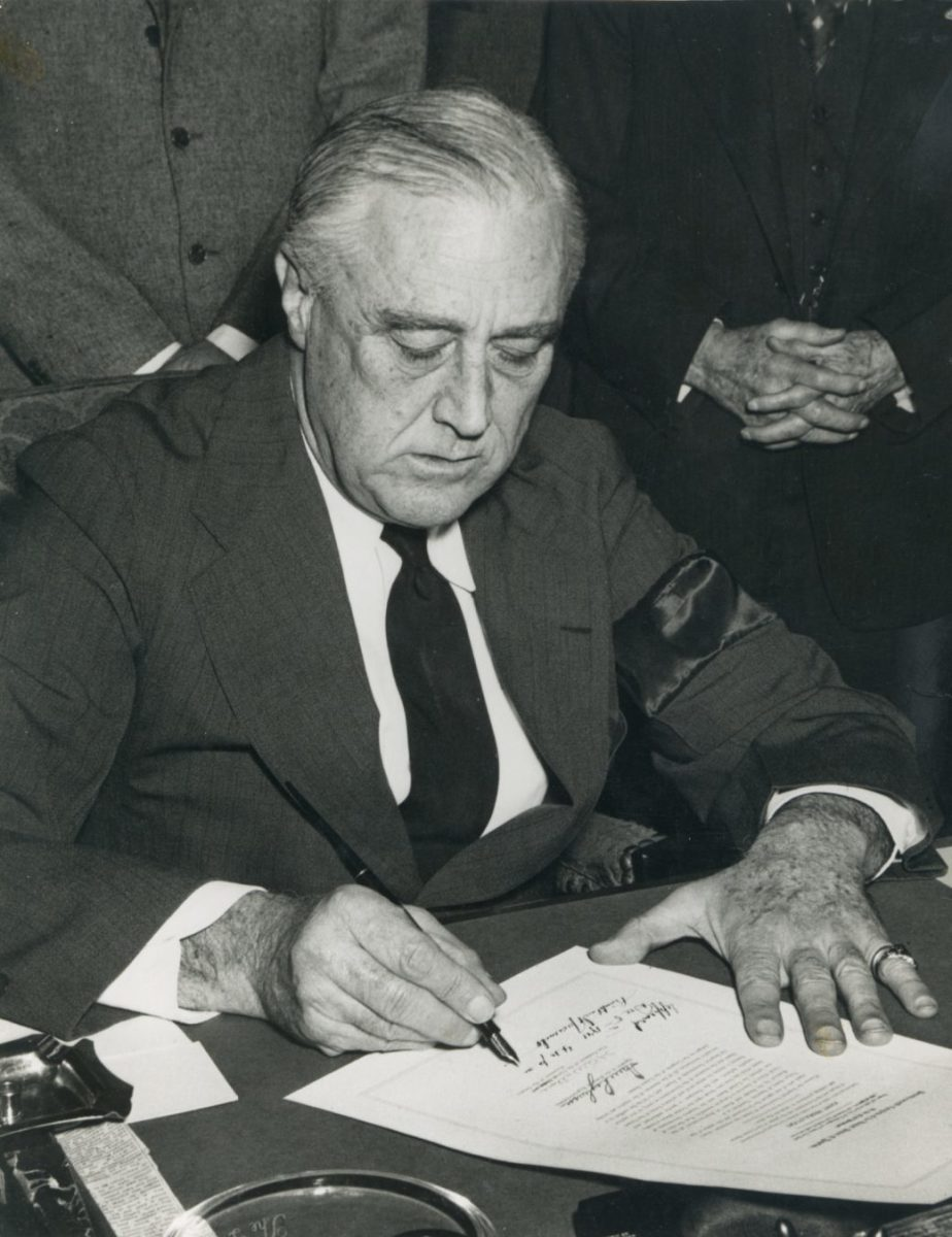 President Franklin D. Roosevelt is shown in the Oval Office signing the Congressional declaration of war against Japan on December 8, 1941, one day after the Japanese attack on Pearl Harbor. Franklin D. Roosevelt Presidential Library and Museum/ NARA