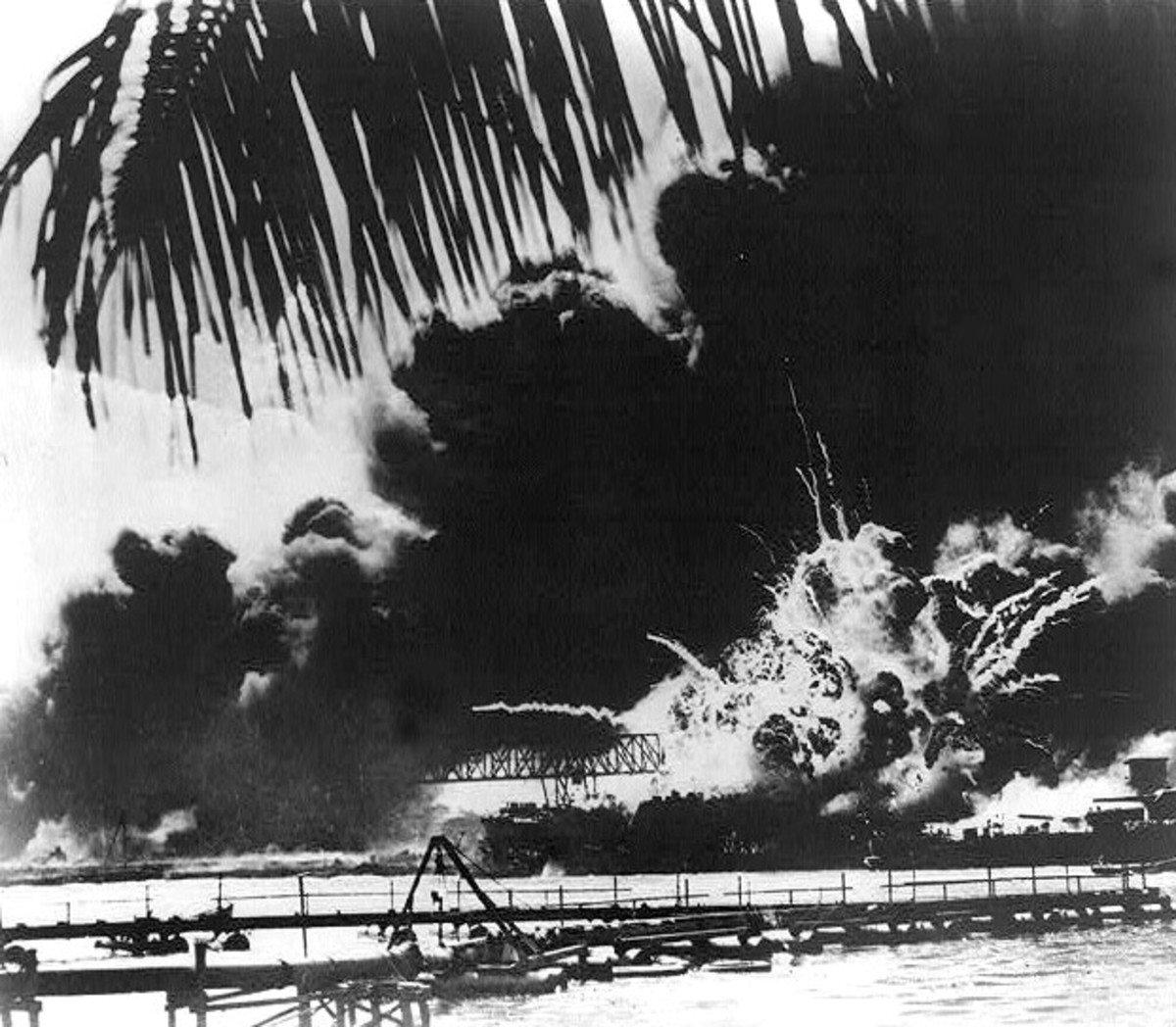 Pearl Harbor naval base aflame after the Japanese attack, 1941. Prints and Photographs Division, Library of Congress. Reproduction Number LC-USZ62-16555.