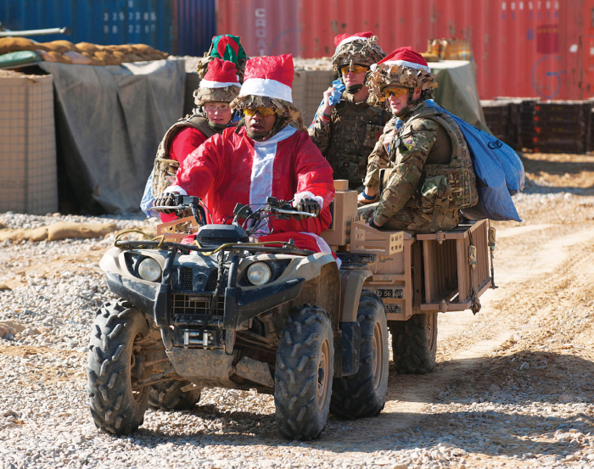 Soldiers of 1st Battalion The Scots Guards are pictured delivering Christmas mail in style on a quad bike at Forward Operating Base (FOB) Oulette, Afghanistan, Dec. 7, 2012.