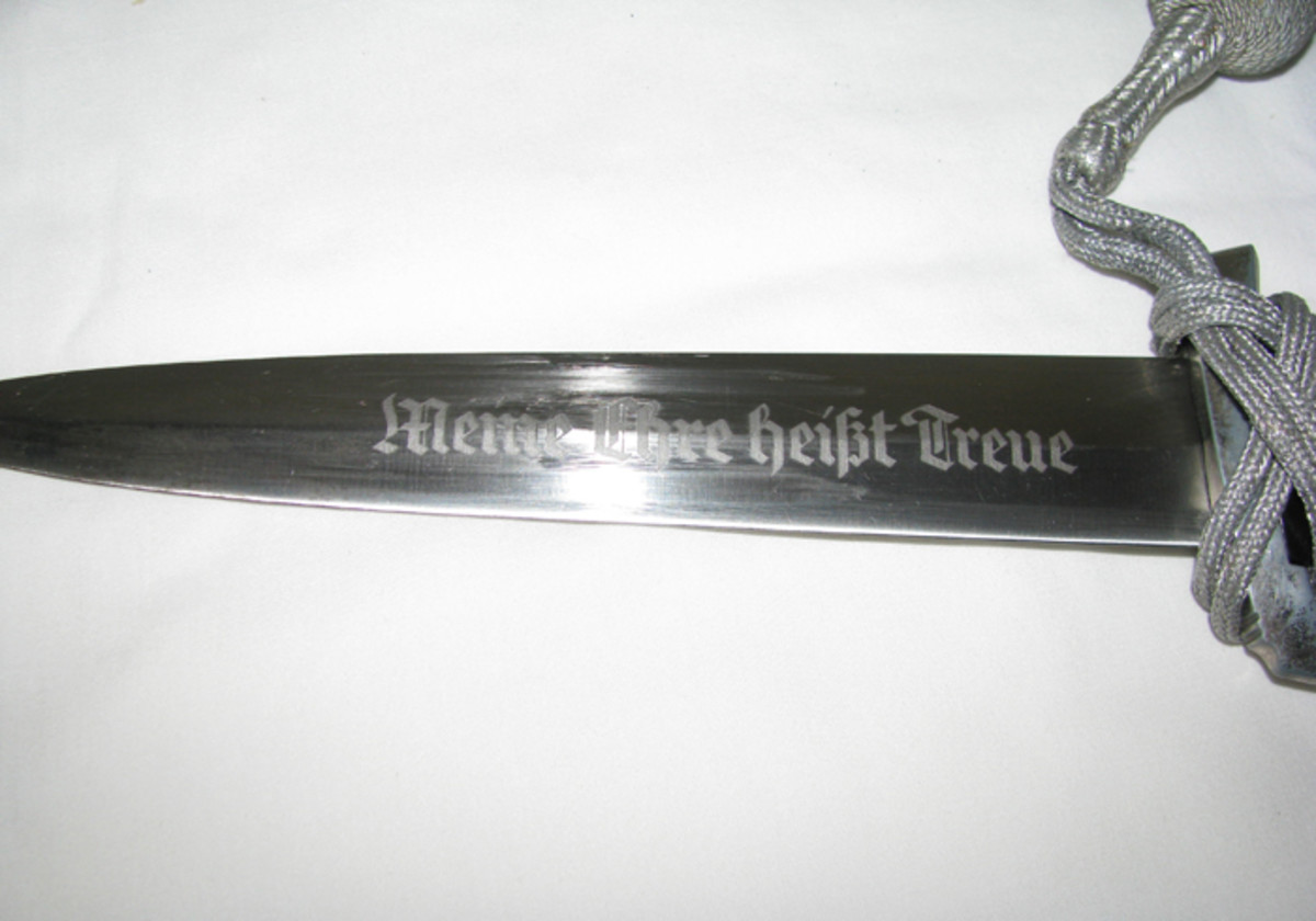 "Both the 1933 and 1936 daggers have the SS motto of ""Meine Ehre Heisst Treu"" on their blades."