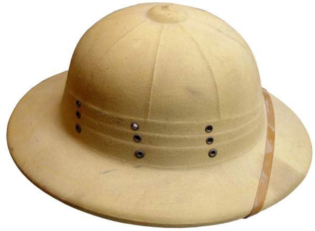 Made by the Hawley Company in Canada this pressed fiber helmet has a slightly different design, including no front hole for the attachment of a badge, and three rows of three vent holes.