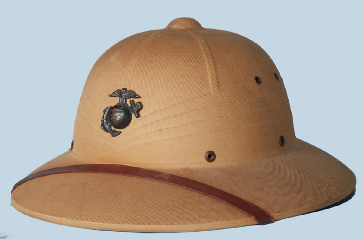 A classic example of an early Hawley produced press fiber sun helmet with a World War II era U.S. Marine Corp EGA.