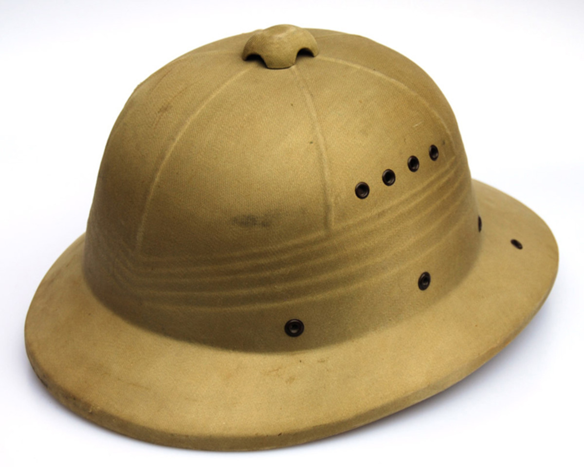 This Canadian example is a unique variation of the pressed fiber helmet, as it features a real ventilator at the top of the helmet.