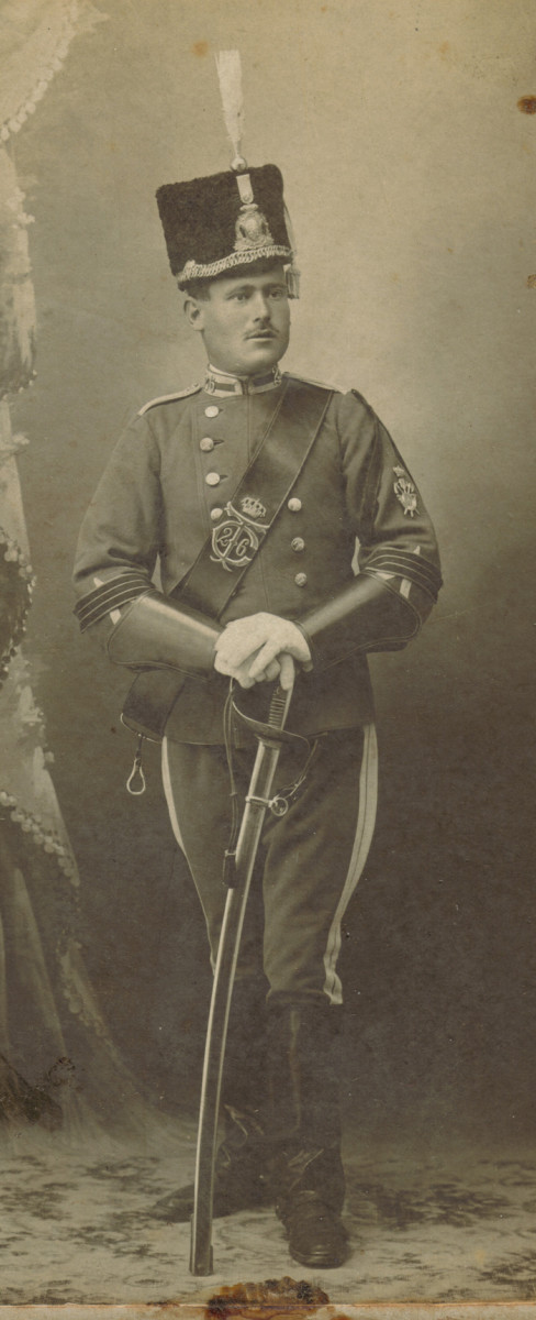 "A Batidor or advance scout of the 26th Light Cavalry - Cazadores de Caballería - Regiment ""Treviño"", ca. 1905, in full dress uniform. The double breasted jacket and breeches are sky blue with white trim. The buttons on the tunic and the metal insignia on the black fur busby are  silver in color."