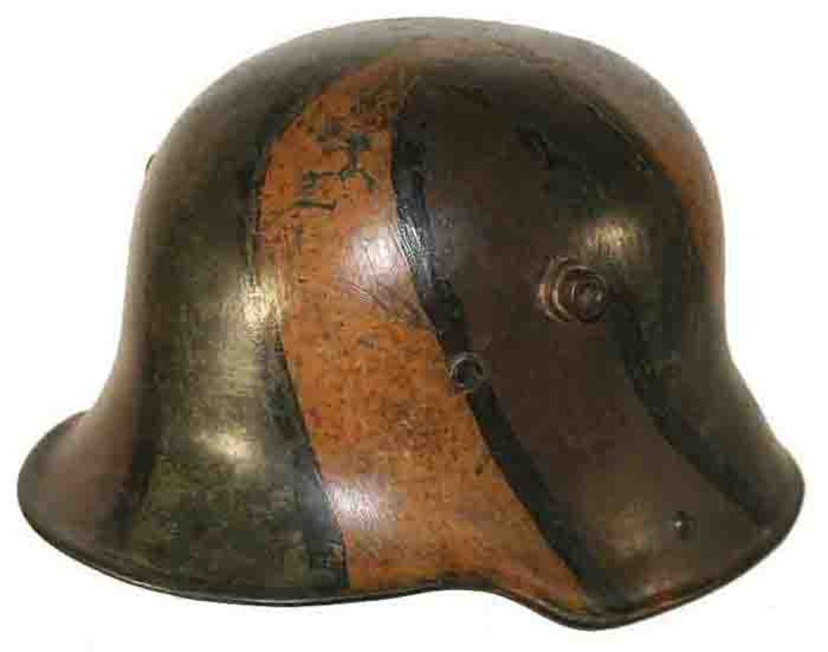 This WWI-era German M-16 camouflage helmet was part of the collection of Hilde's father sold by Grenadier Auctions.