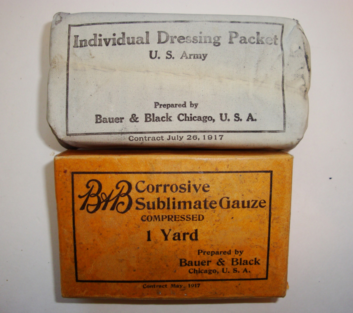 "The third pocket contained two boxes of Sublimate Gauze (bottom), while pockets four thru eight each held the newly designed ""Individual dressing packet"" wrapped in a white oilcloth wrapper."