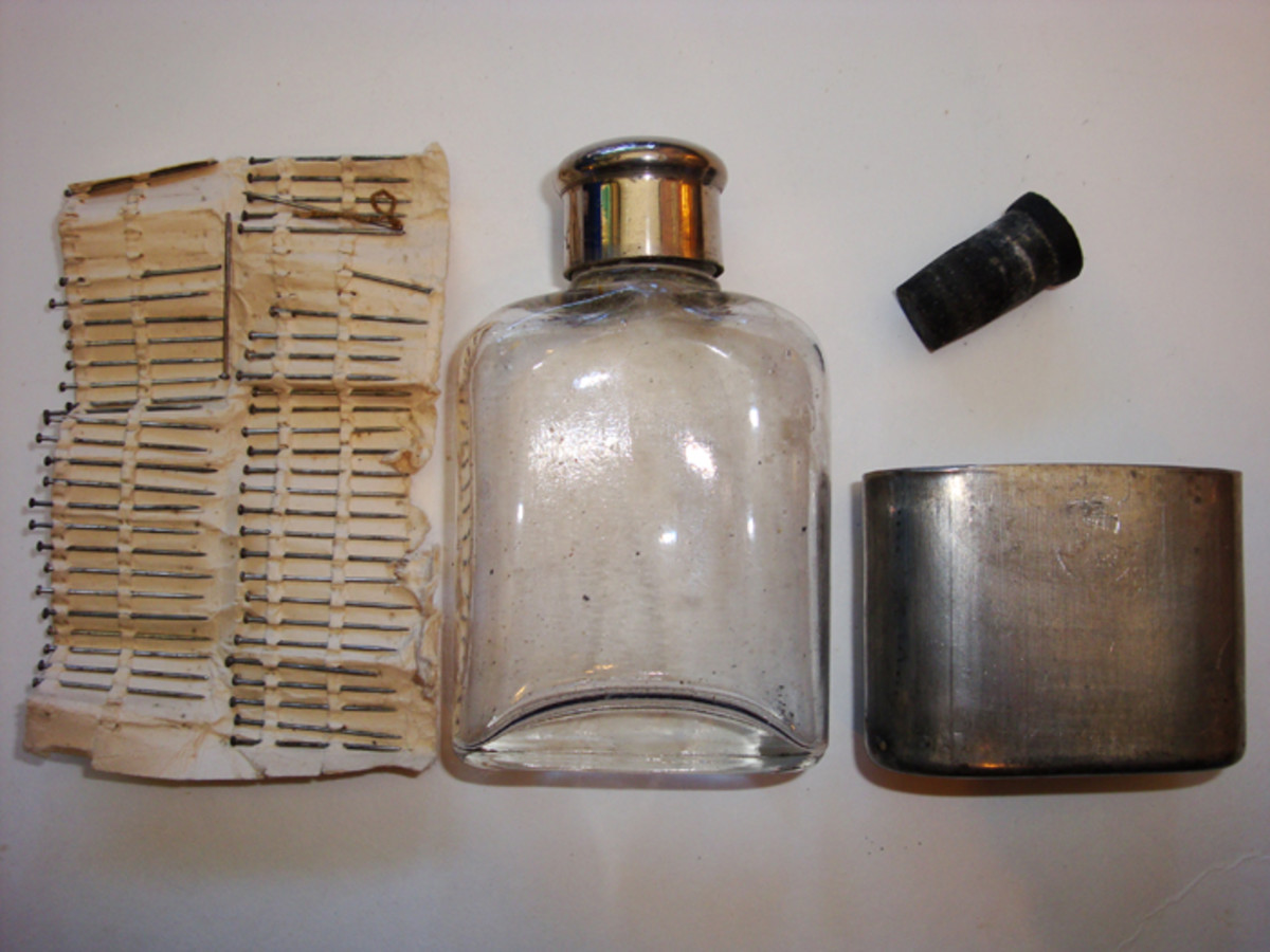 Pocket Number 10, the front right pocket,  contained the spirits of ammonia flask and cup, along with about 12 dozen common pins rolled up on a card and placed in the smaller pocket inside.