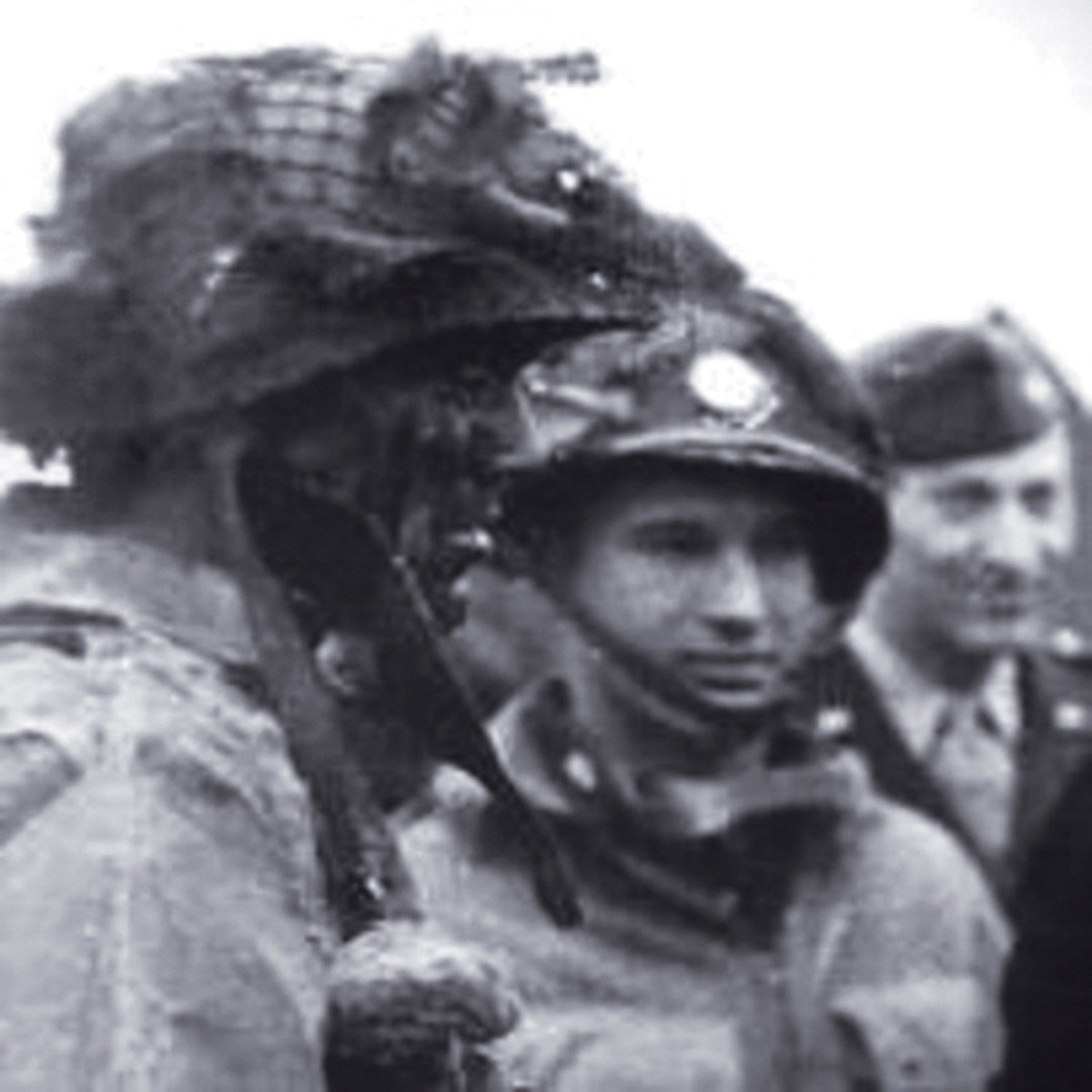 During WWII, US troops used luminous disks for marking personnel, equipment, bridges, etc. They were filled with radium which constantly gave off weak, green light due to its radioactivity. Luminous discs were issued on a very limited scale to paratroopers (like these of the 101st Airborne) who were about to make the jump at Normandy during the D-Day invasion.