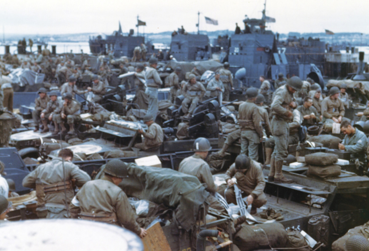 Men and equipment are massed together in landing craft in preparation for the big assault on the European continent.