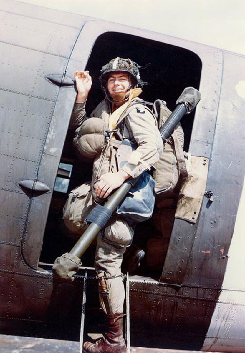 US 101st Airborne Division paratrooper Corporal Louis E. Laird boarding a C-47 transport during dress rehearsals for the Normandy invasion, spring 1944