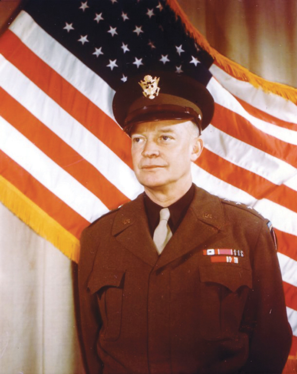 The mastermind behind the Normandy invasion was General Dwight Eisenhower. This photo was taken when Eisenhower was SCAEF (Supreme Commander Allied Expeditionary Force) and head of (SHAEF) Supreme Headquarters Allied Expeditionary Forces. He wears the SHAEF patch on his left shoulder.