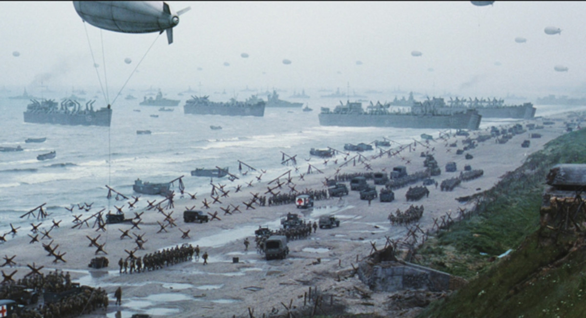 "Don't believe all that you see — while this is a great depiction of the invasion force, it is really a still from the movie, ""Saving Private Ryan."" Actual color photographs taken during the opening hours of the D-Day invasion are near non-existent."