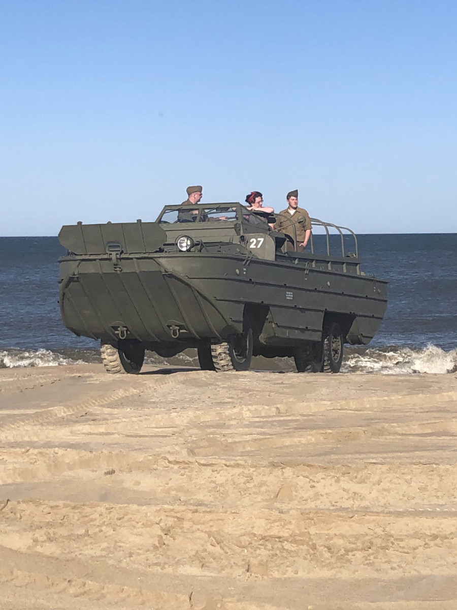 Wheels of Liberation's 1944 GMC DUKW on the beach in Lewes, Delaware