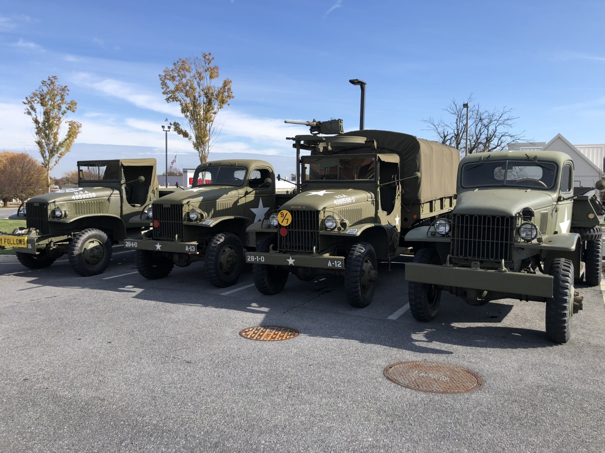 Left to right: Paul Rea's 1945 CCKW cargo dump, Brian Cessna's 1942 CCKW cargo, Paul Rea's 1942 CCKW cargo, and John Gott's 1940 Chevy dump.