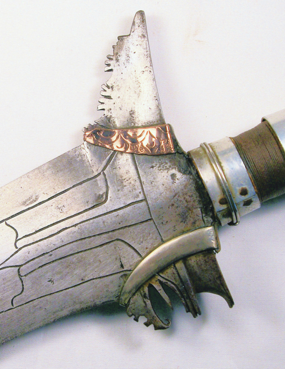 """Close up of the rear end of the blade showing the engraved band denoting royal """"Datu """"or princely ownership. The lower band is of steel and matches the blade."""