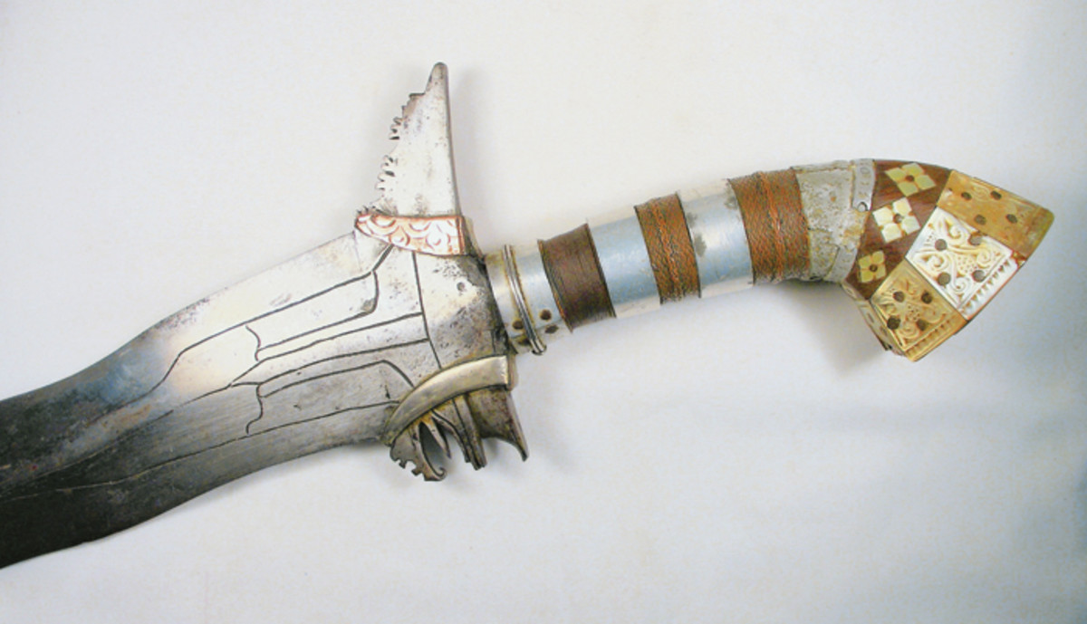 """Close up of the entire hilt showing the fancy trim of silver and mother of pearl of the """"Bloody Kris."""""""