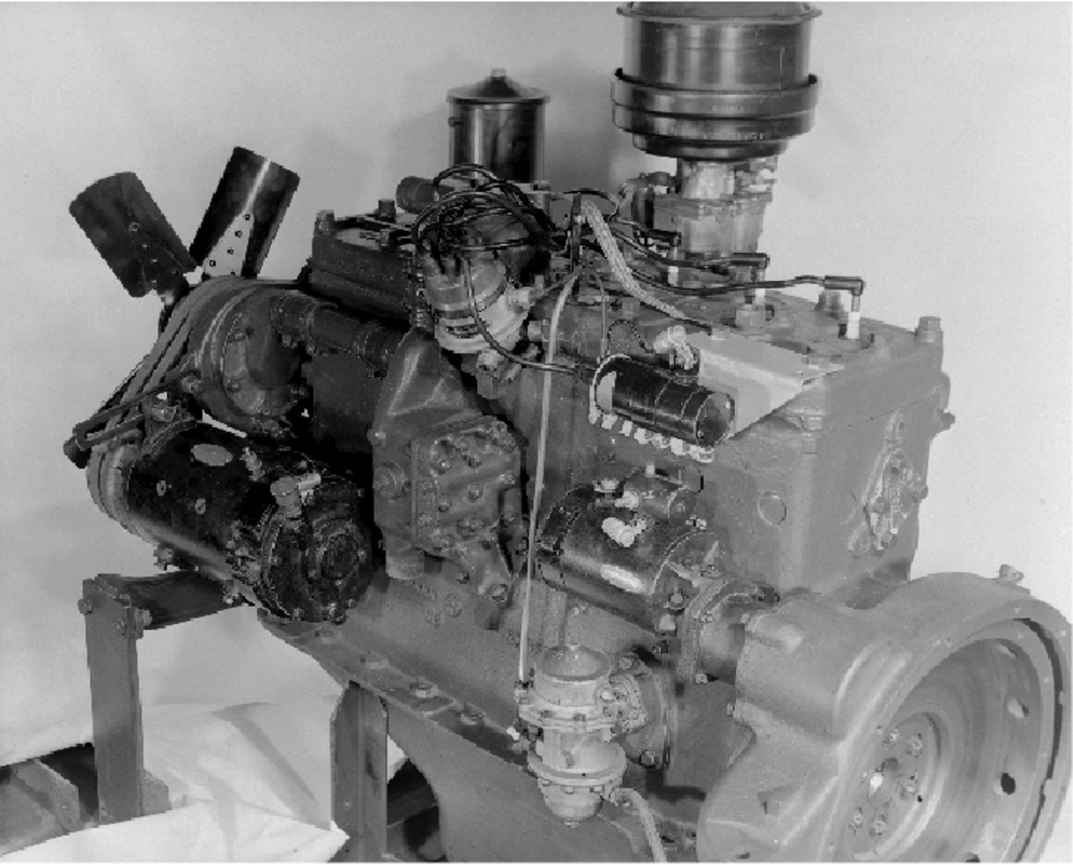 The power plant for the M2 and M2A1, regardless of manufacturer, was the White-built 160AX six-cylinder gasoline engine. This particular engine was assembled after September 1942, as denoted by the five-bladed fan and metal fuel filter bowl.