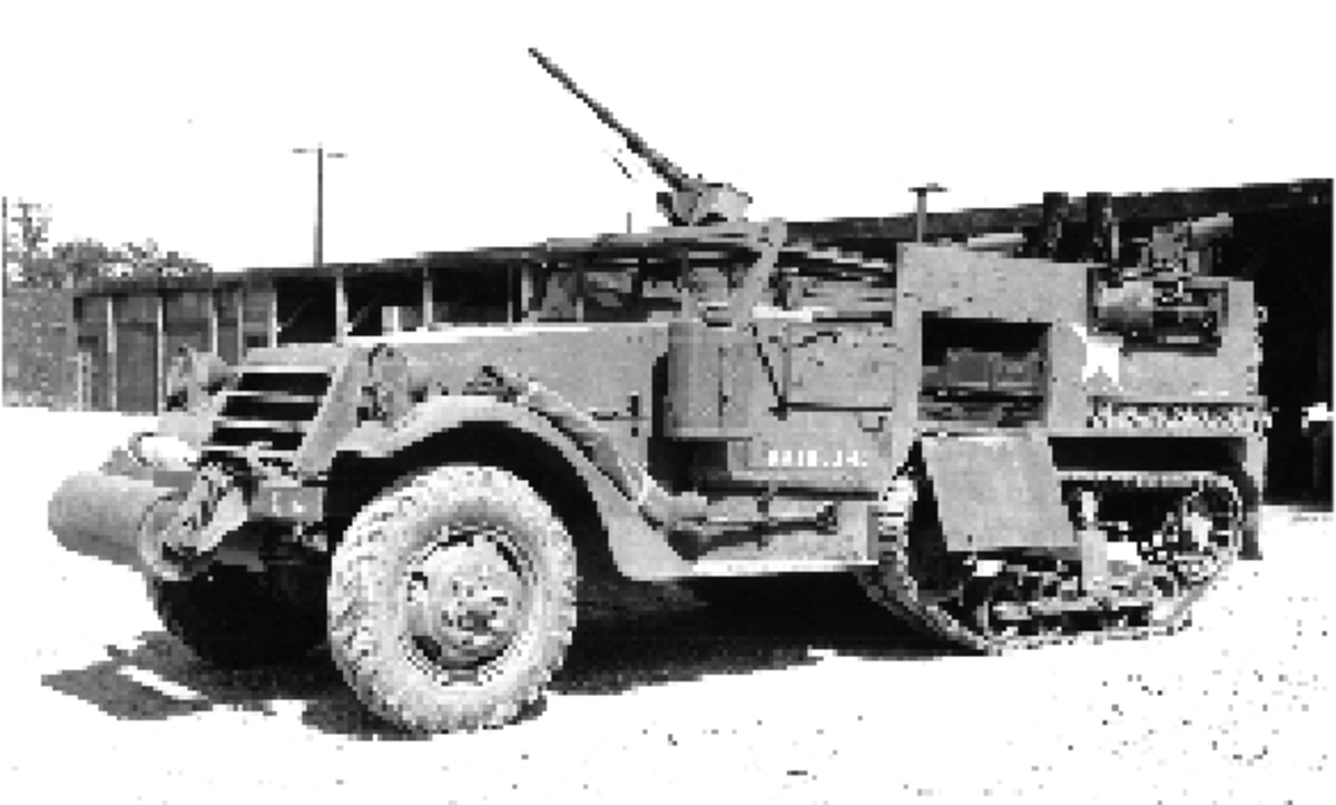 The side-mounted mine racks visible on this M2 are a result of an August 21 1942 directive from the Office, Chief of Ordnance. A February 1943 MWO (G102-W21) required that these mine racks be retrofitted to vehicles already in the field. The pioneer tool rack seen on the side was a non-standard modification.
