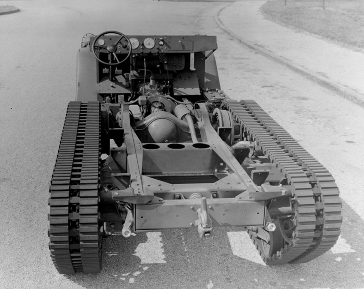 "Mechanically, the M2 as well as the other halftracks in the SNL G-102 group were merely trucks, with the track bands being driven by the rear ""wheels"" – actually midships-mounted drive sprockets."