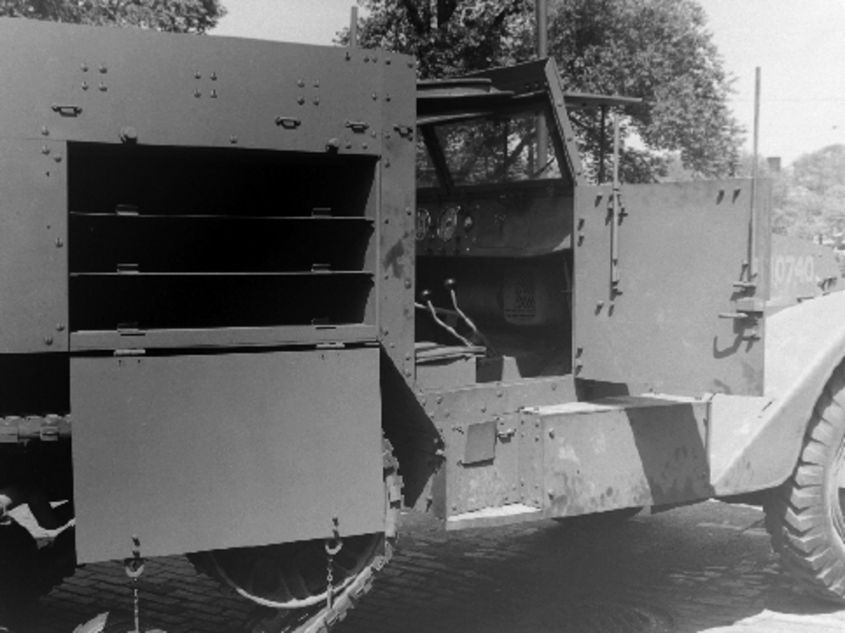 This M2, photographed in June 1941, has bullet-resisting self-sealing inner tubes. The mast for the radio antenna can be seen protruding from the center of the fighting compartment.