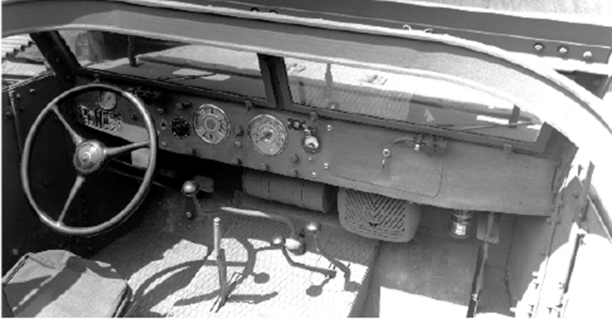 The driver's area of an early M2. To the left of the steering column is a tachometer, and to the right, an electric brake controller – befitting its prime mover design.