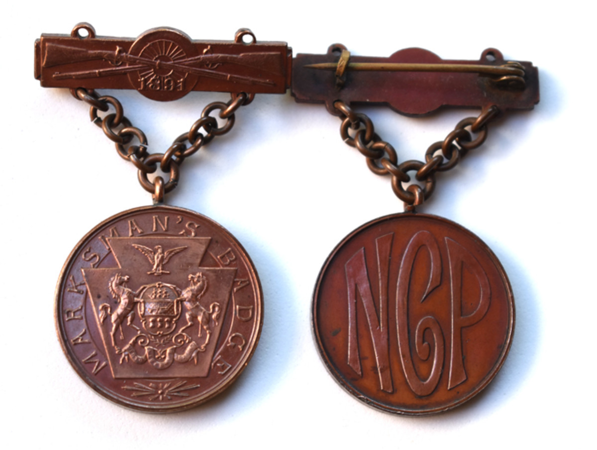 An early Pennsylvania National Guard Rifle qualification badge considered a Type 1 Rifle badge.