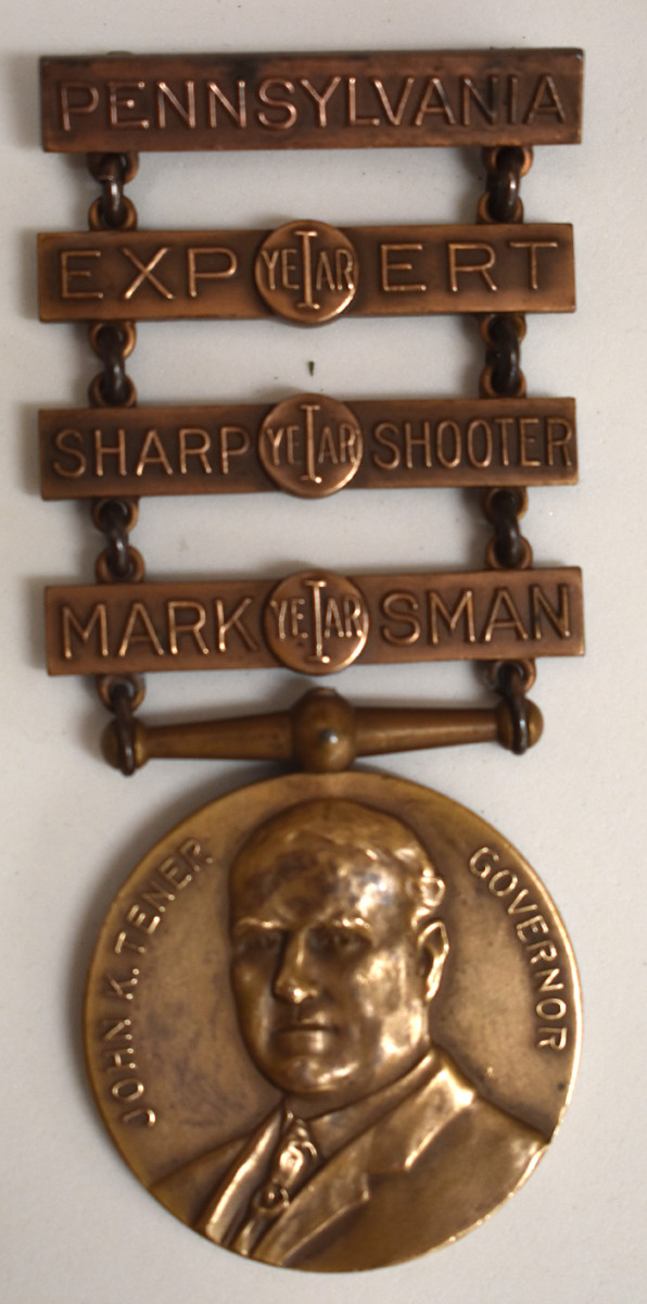 A Type 4 Tener badge incorporated a new design with 3 different qualification bars.
