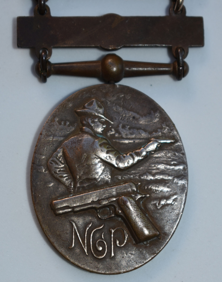 The reverse of the Type 3 Pistol Badge shows the newly adopted .45 caliber Colt adopted by the Pennsylvania National Guard.