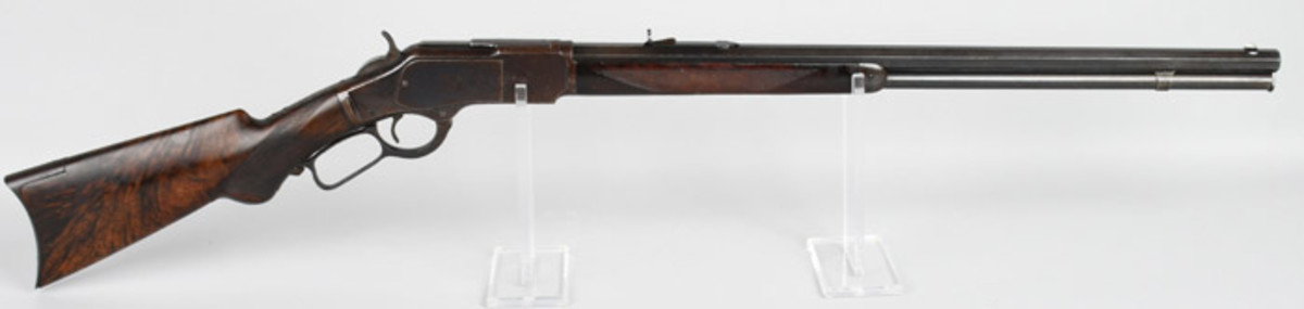 High-condition Winchester Deluxe 1873 .22 caliber rifle, made in 1892. Gorgeous woodgrain and patina. Superior example of an extremely rare firearm.