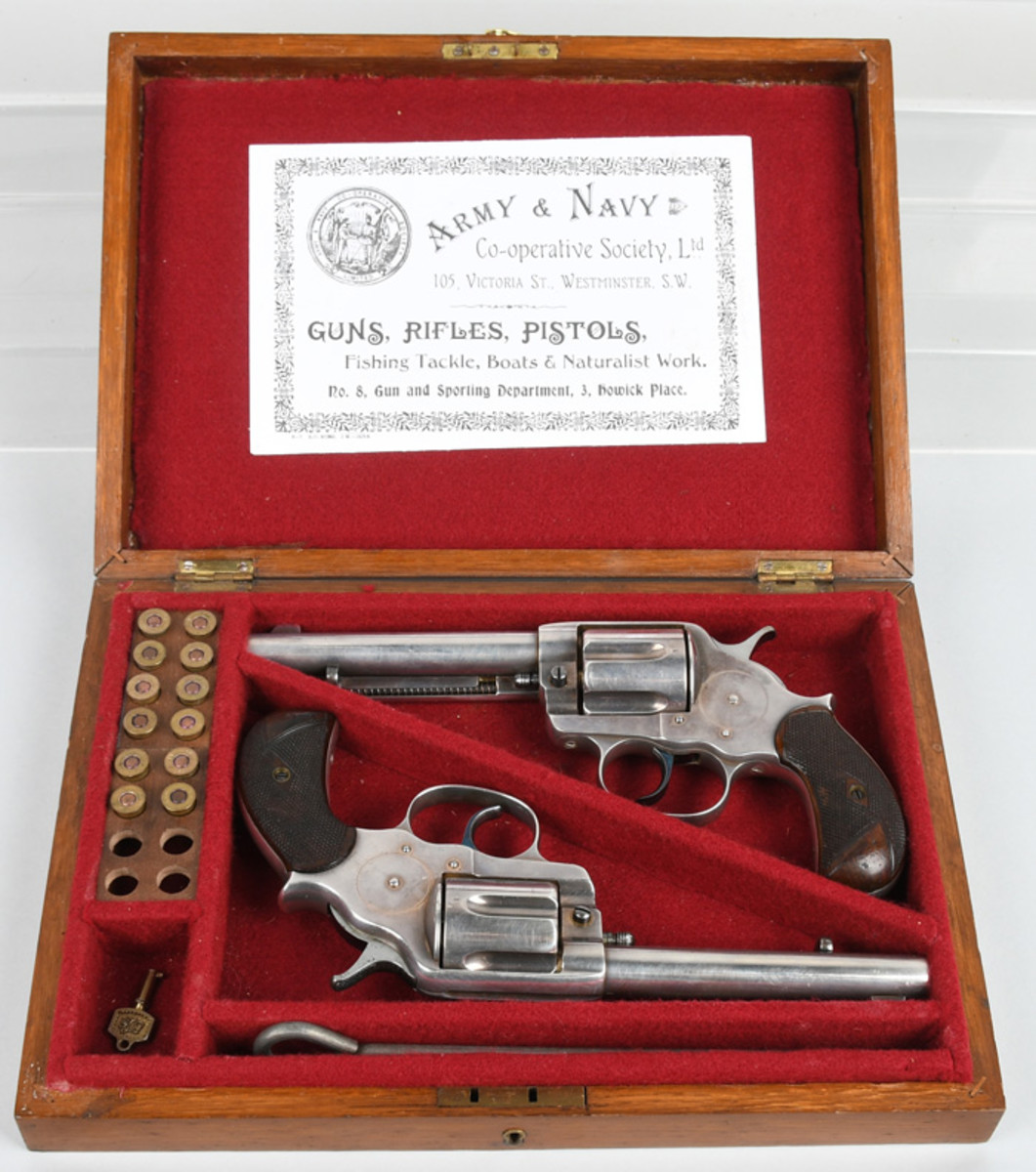 English silver-plated Colt Model 1878 double-action revolvers, British proofs on cylinders, London barrel address on both, made in 1882 and 1885, respectively; the latter sold new to a British Army officer.