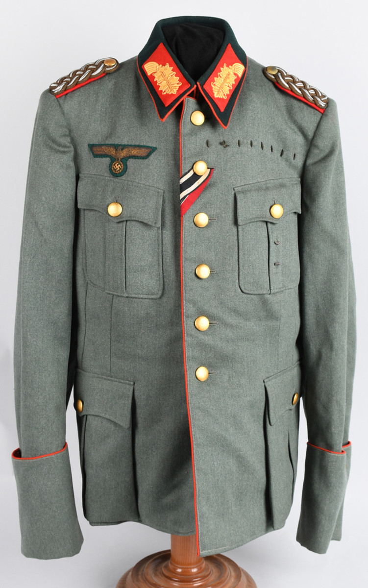 World War II Nazi German Heer (Army) general's ID'd tunic, hand-embroidered eagle holding swastika patch, decorative collar and epaulets.