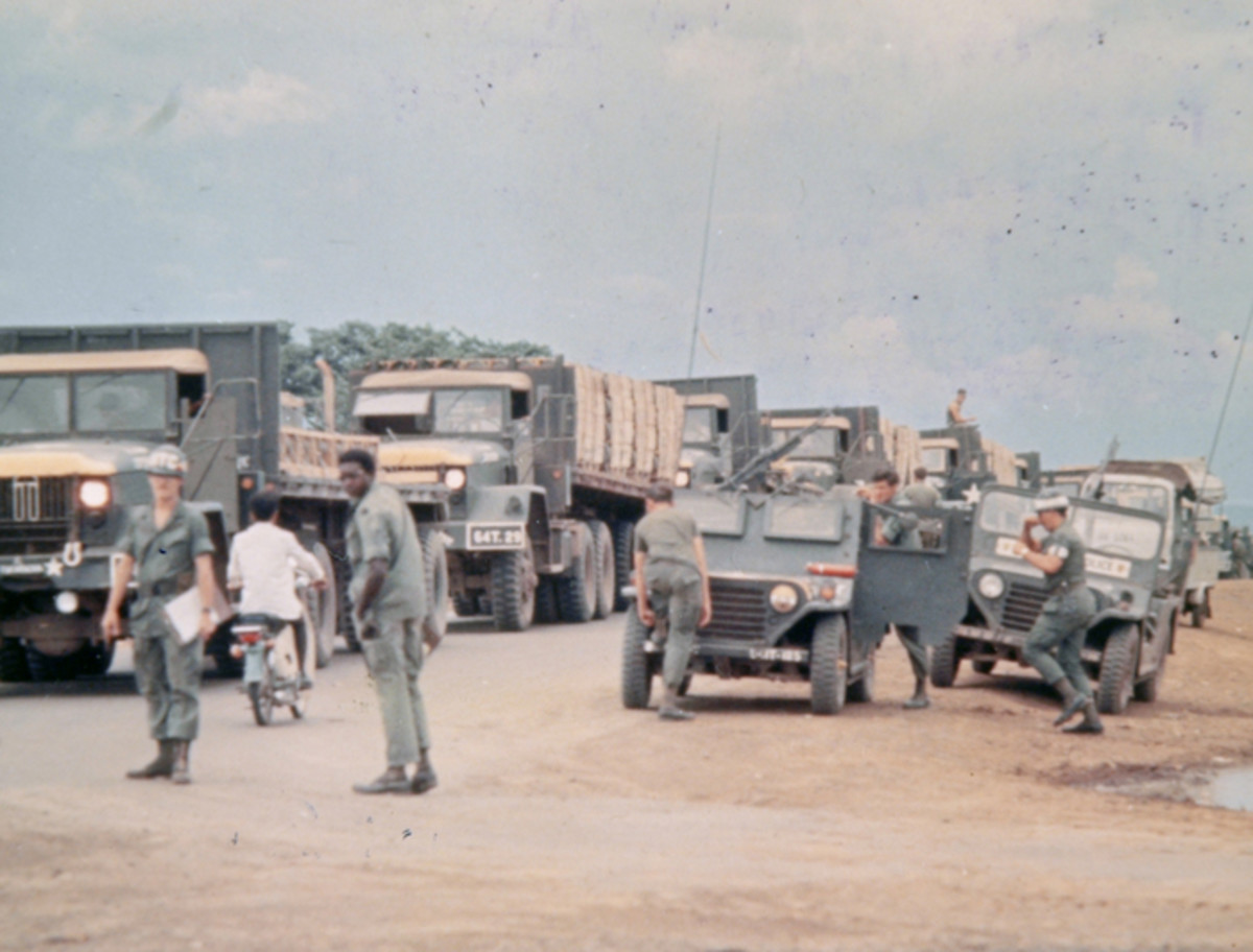A pair of M151s equipped with armored windshields and doors prepare to escort a convoy departing An Khe 10 June 1970. The MUTT, a being designed as a light tactical vehicle, was not well-suited for this type use, a lesson that was forgotten in the 35-years after this photo was taken.