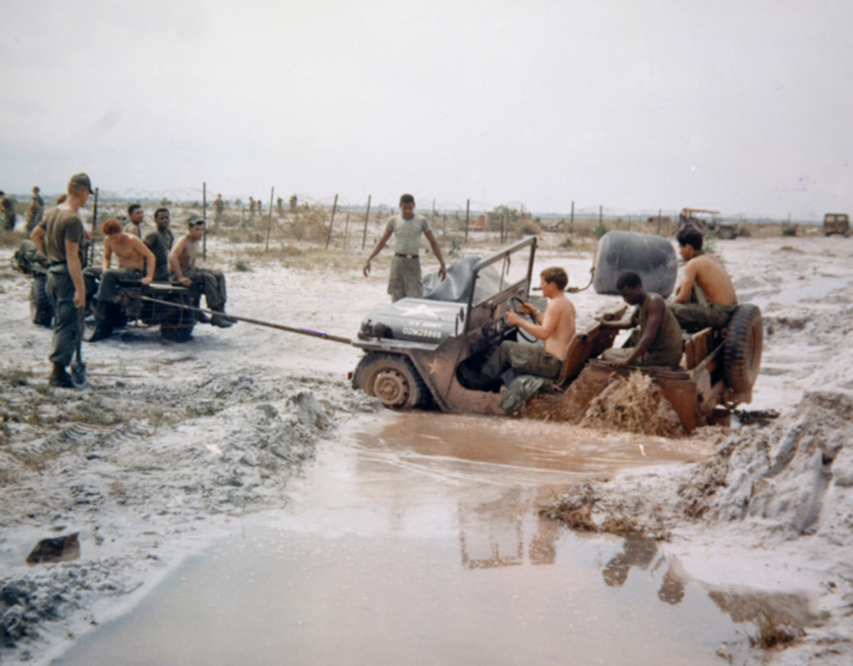 This mired M151 belonging to the 101st Airborne Division, was photographed 12 October 1969 being extricated by a Mechanical Mule. Notice that several GIs are on the Mule – and the MUTT – in an effort to improve traction.