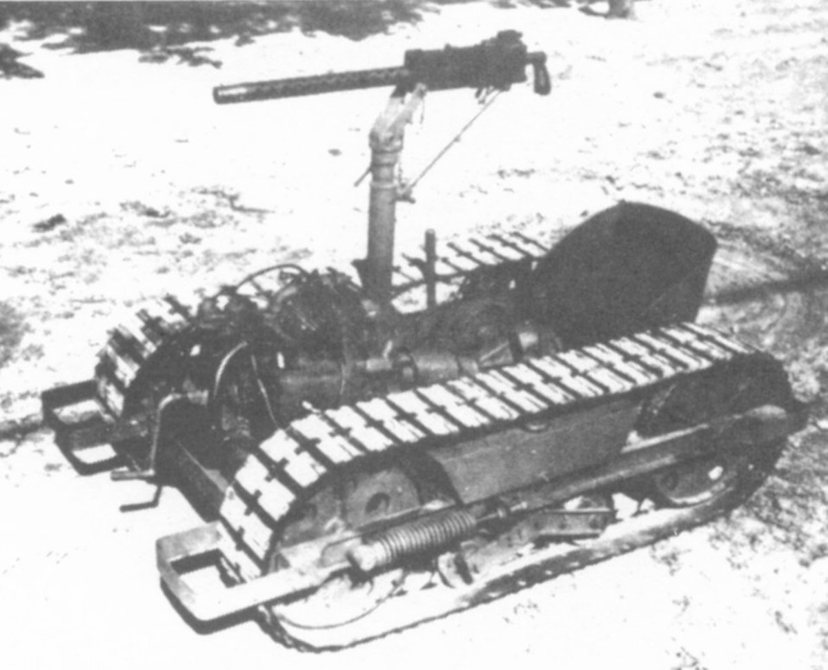 With the addition of a gun mount, the Crosley Tug became a Self-Propelled Gun. (Note the bumpers with spring backups.)